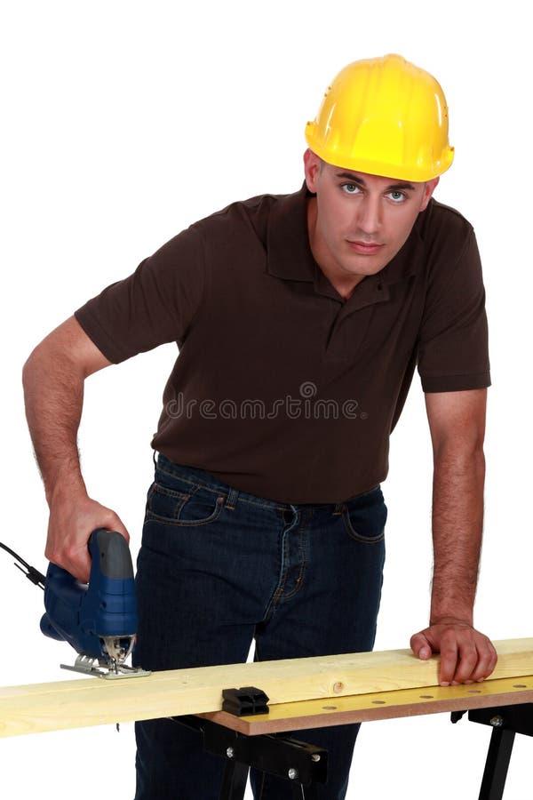 做孔的工匠 库存照片