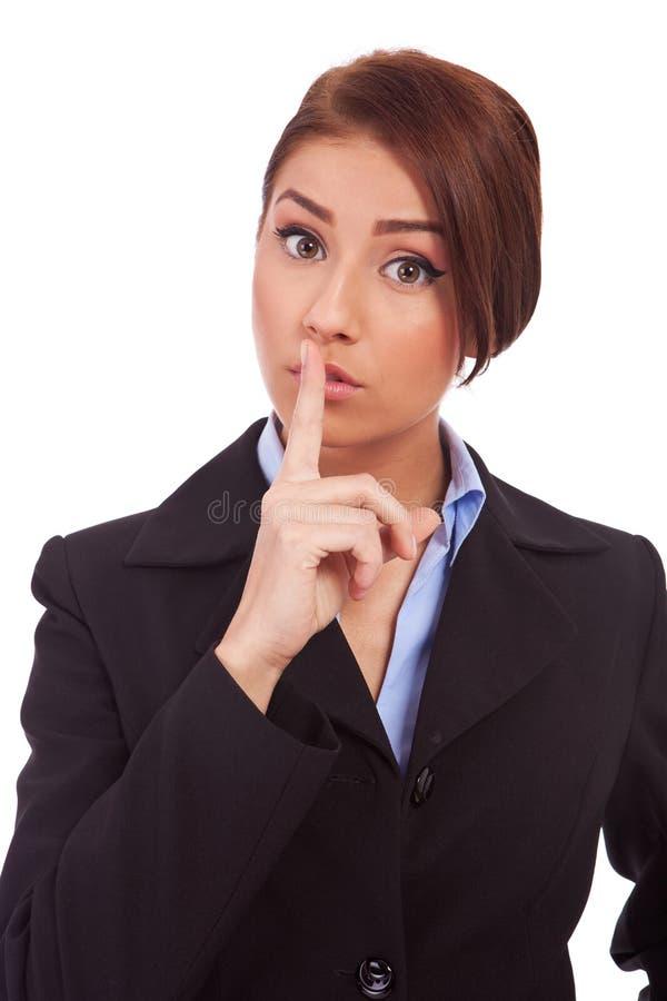做平静的妇女的企业姿态 免版税图库摄影