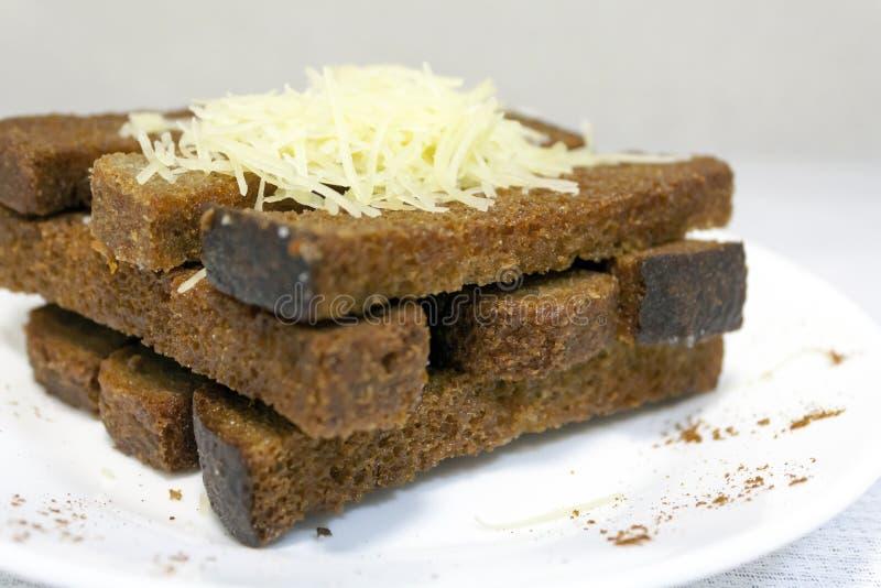 做得好酥脆油煎方型小面包片 图库摄影