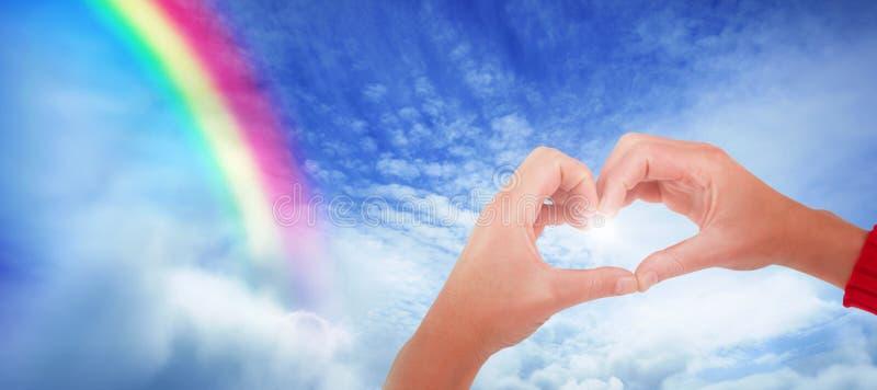 做心脏形状用手的妇女的综合图象 免版税库存图片
