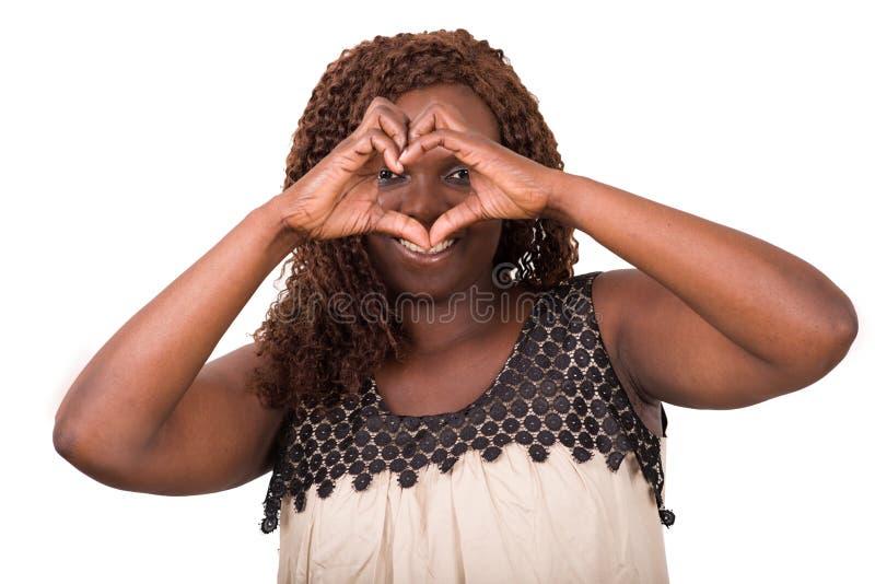 做心脏标志的妇女隔绝在白色背景 免版税库存照片