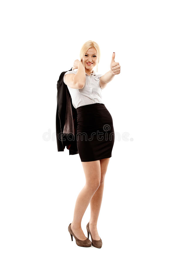 做标志的快乐的女实业家手指 免版税库存照片