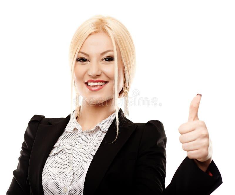 做标志的快乐的女实业家手指 库存图片