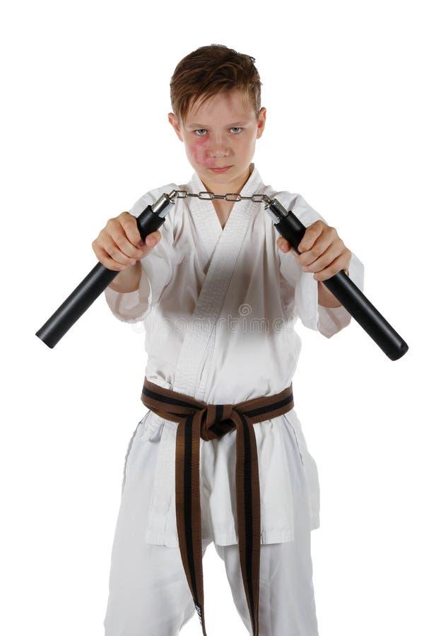 做武道的十几岁的男孩 免版税库存照片