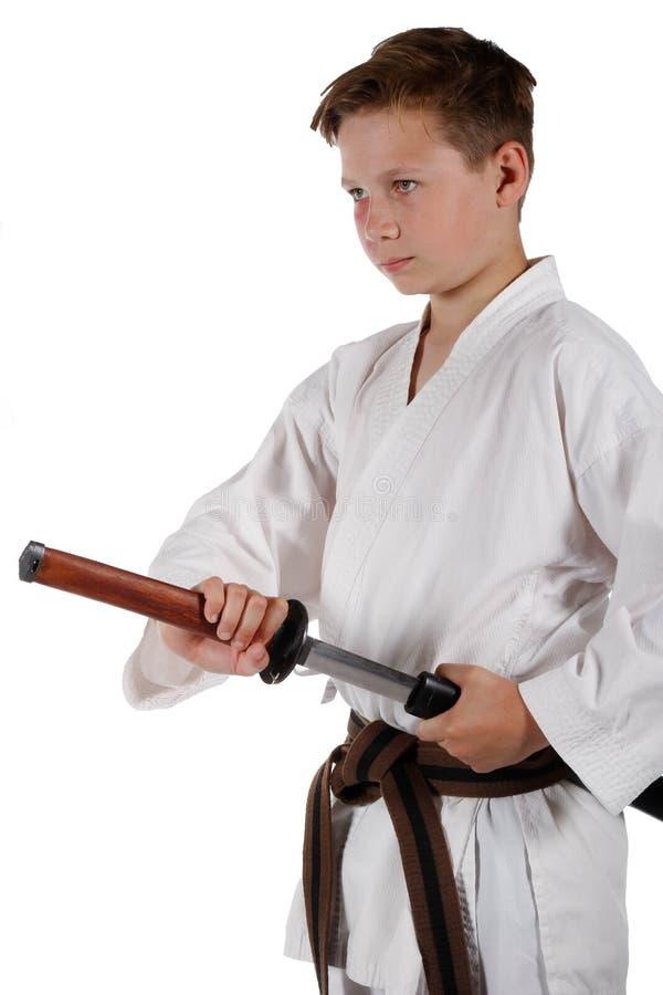 做武道的十几岁的男孩 库存图片