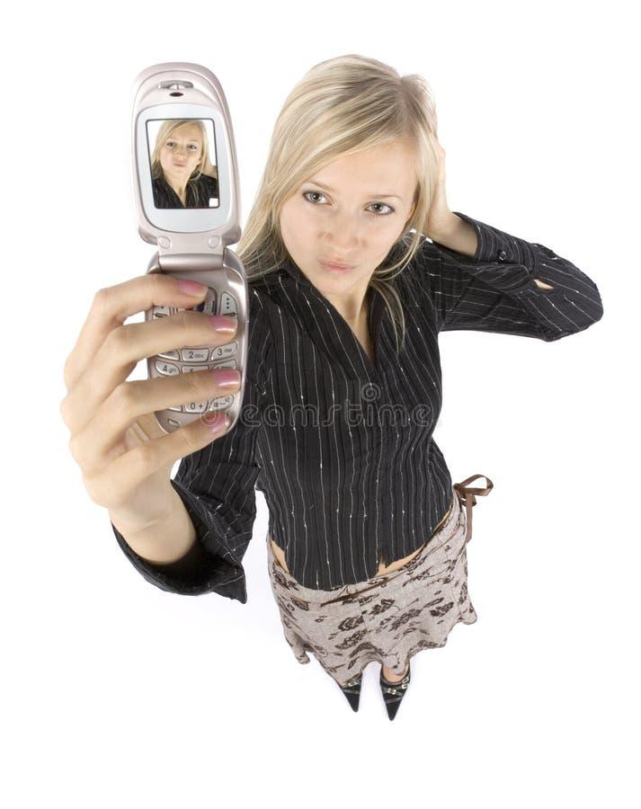 做照片电话妇女年轻人的白肤金发的he 库存照片