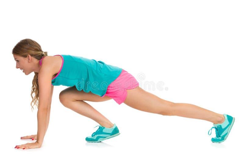 做爬山者锻炼被隔绝的外形的妇女 库存图片
