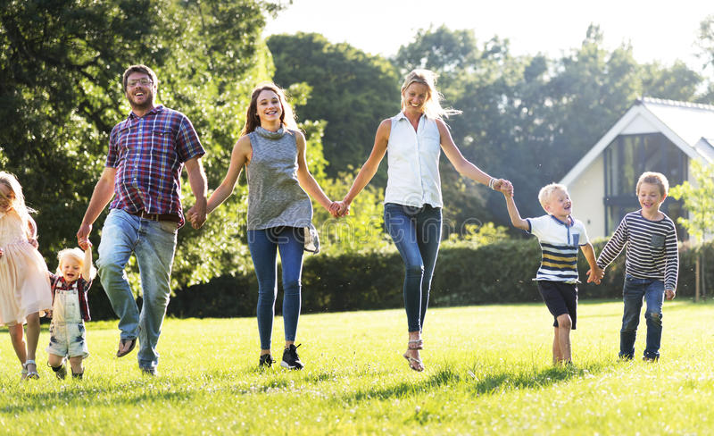 做父母统一性放松概念的家庭世代 库存照片