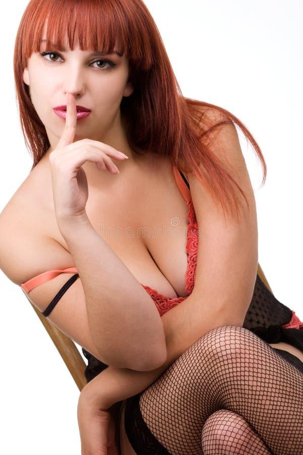做理想的红头发人符号沈默的女孩 图库摄影