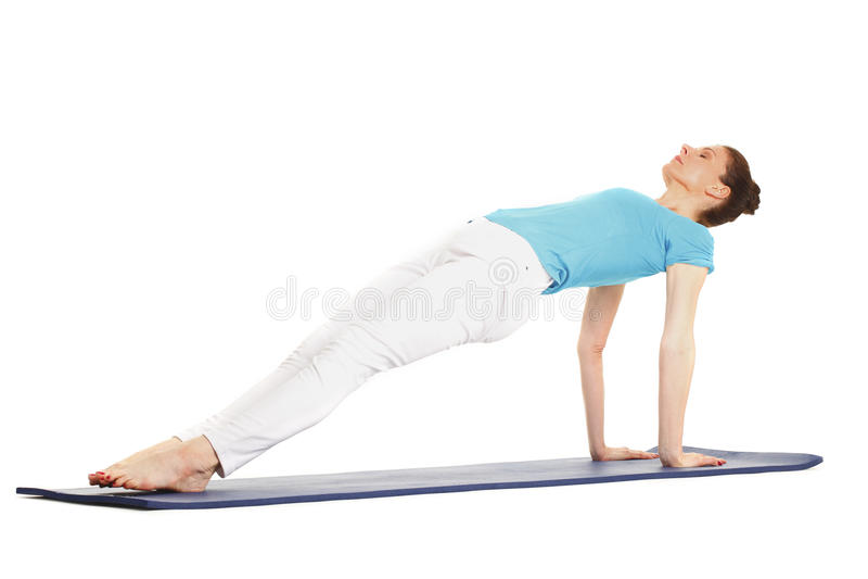 做瑜伽的妇女 库存照片