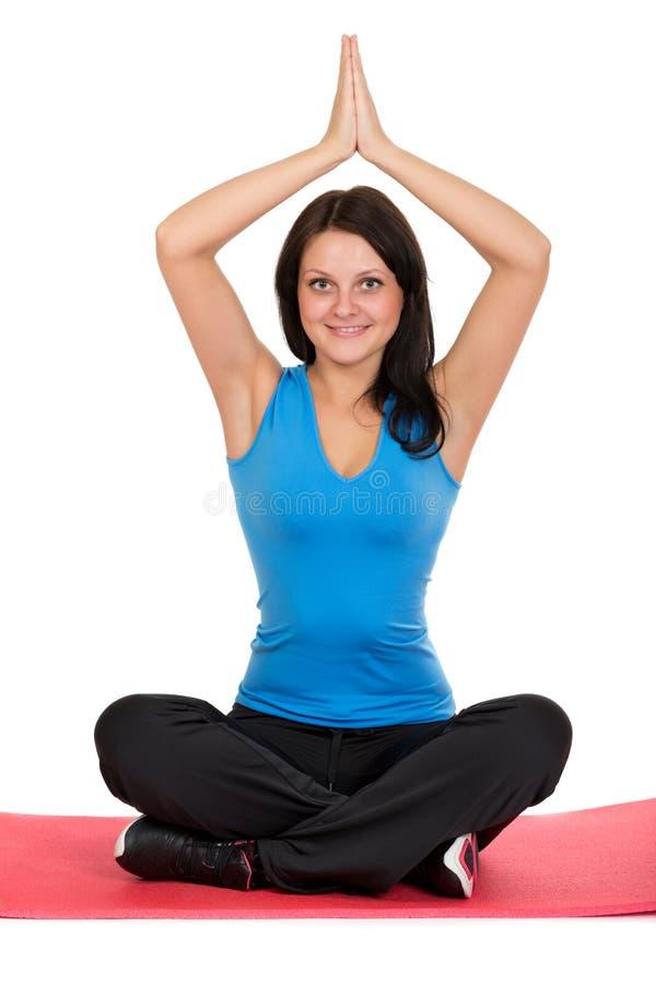 做瑜伽的美丽的女孩 库存照片