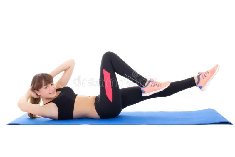 做腹肌的少妇锻炼隔绝在wh 免版税库存图片