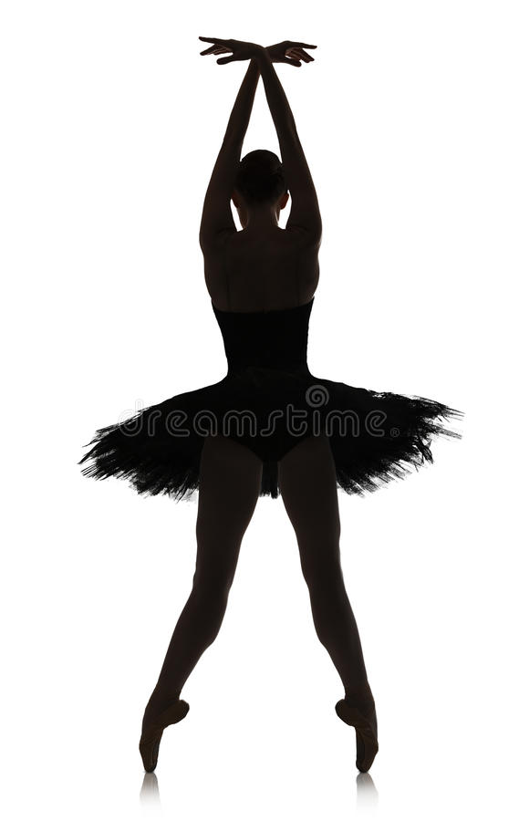 做芭蕾位置的芭蕾舞女演员剪影反对白色背景,被隔绝 库存照片