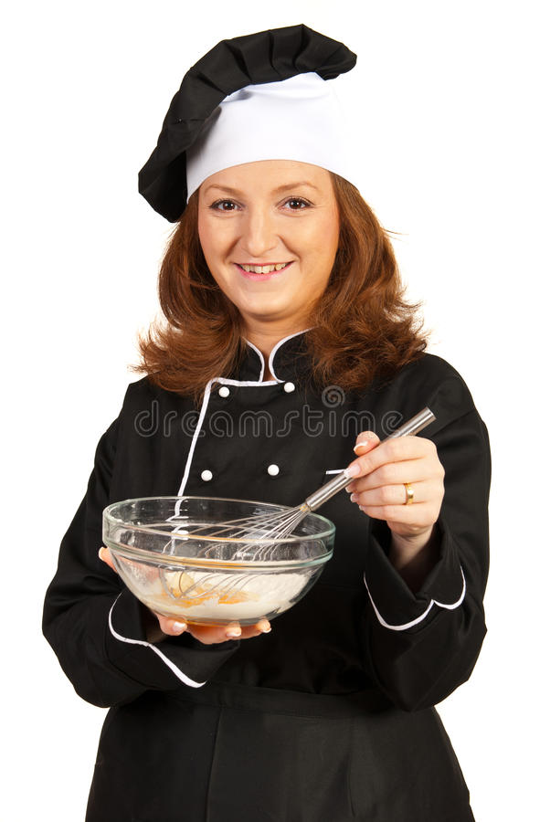 做薄饼面团的厨师妇女 库存照片