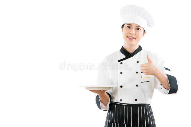 做赞许姿态的厨师 免版税库存图片