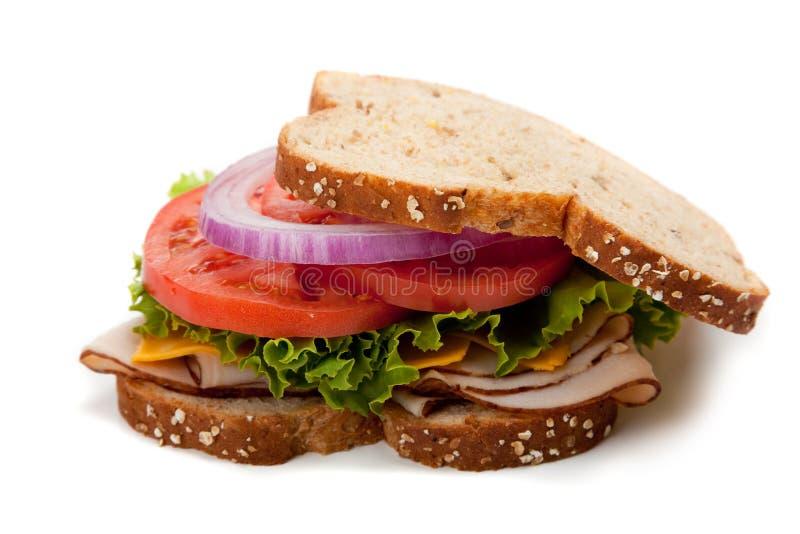 做面包的粮谷全部三明治的火鸡 库存图片