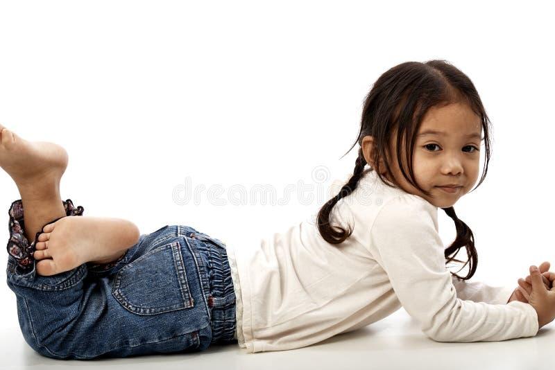 做鬼脸甜的小女孩 库存照片