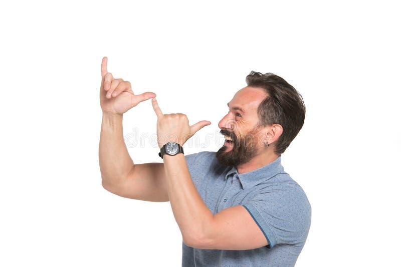 做鬼脸用手的正面有胡子的人档案  库存图片