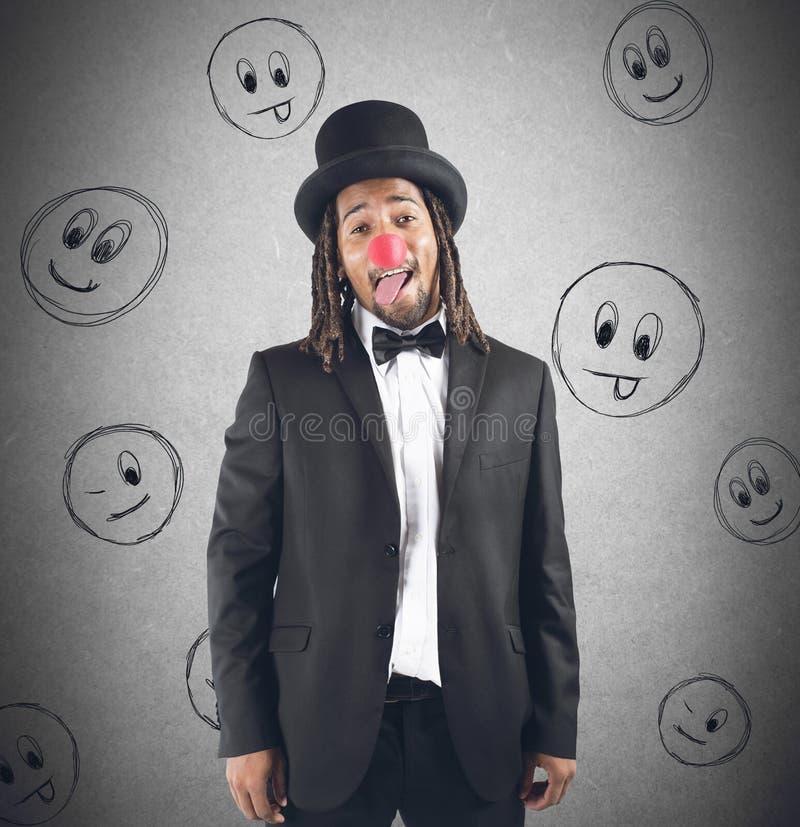 做鬼脸的小丑 库存图片