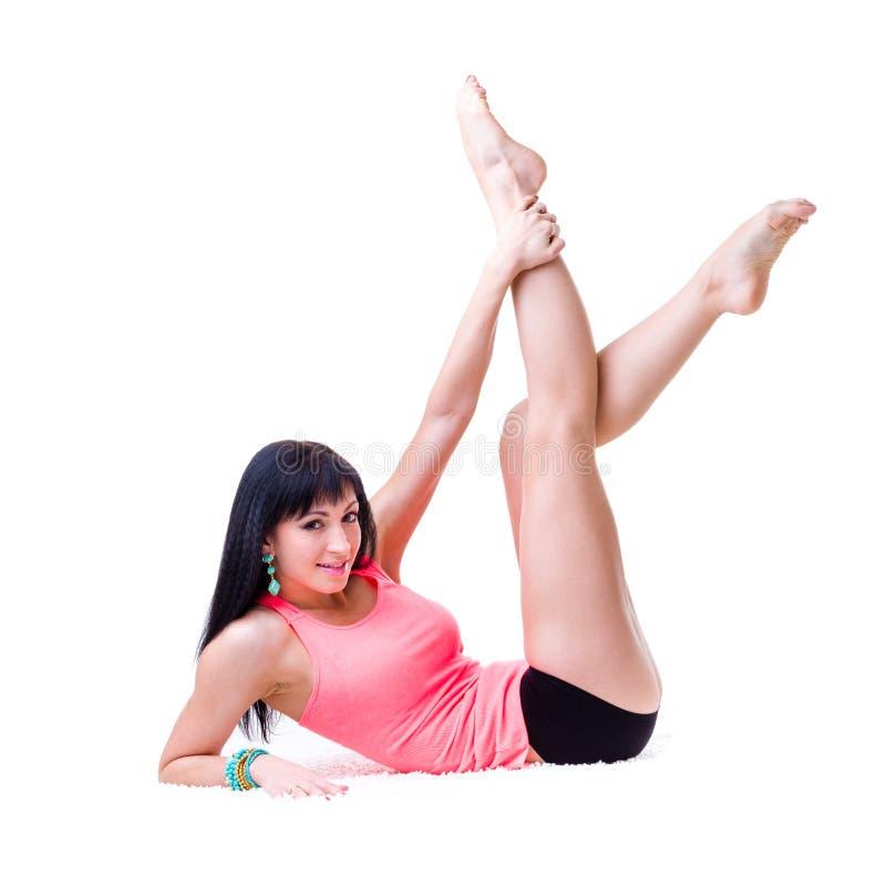 做锻炼的美丽的运动的妇女 免版税库存照片