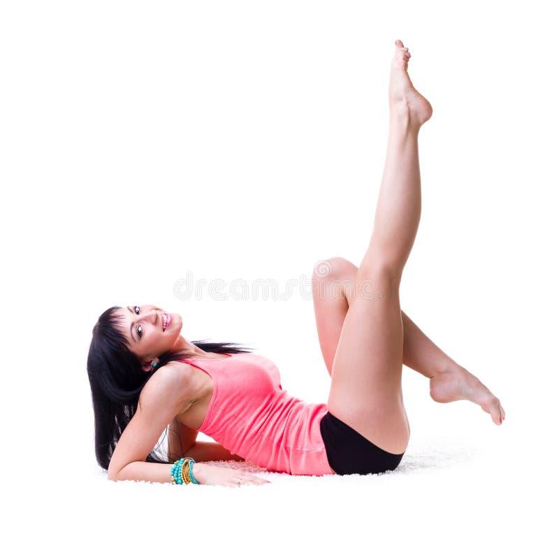 做锻炼的美丽的运动的妇女 库存照片
