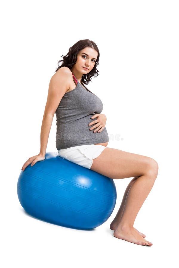 做pilates锻炼的孕妇 库存照片
