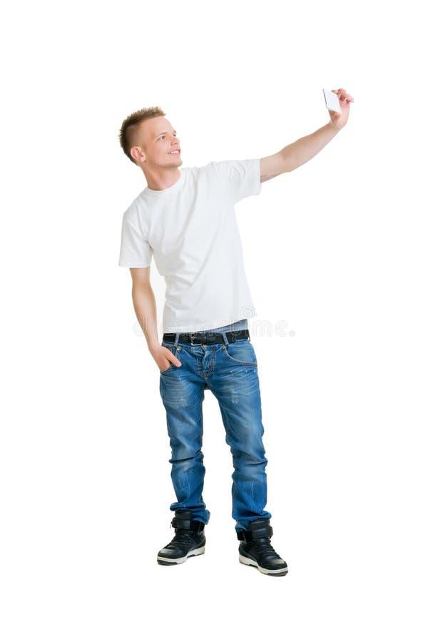 做selfie的十几岁的男孩 图库摄影