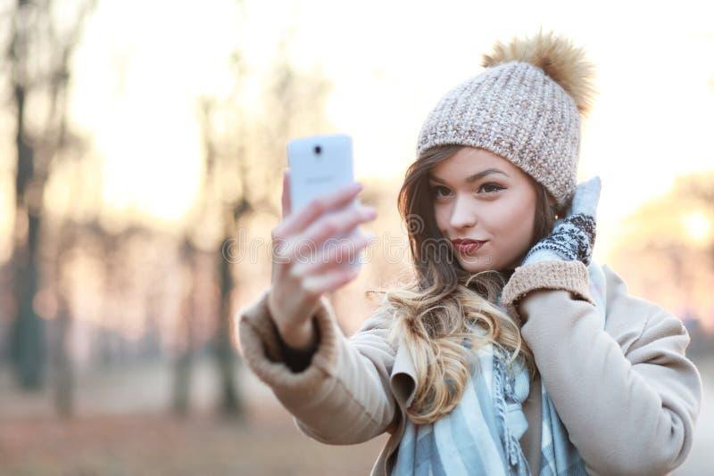 做selfie的妇女 库存图片