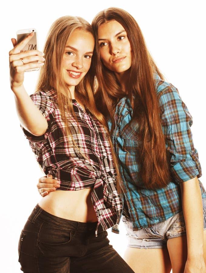 做selfie的逗人喜爱的十几岁的女孩被隔绝 库存图片
