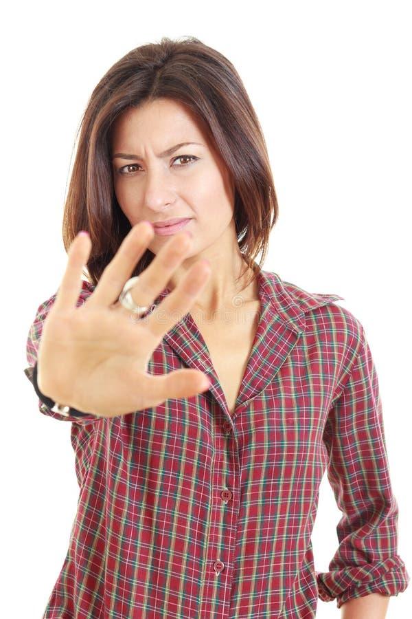 停止充满年轻俏丽的妇女显示的愤怒的姿态 免版税库存图片