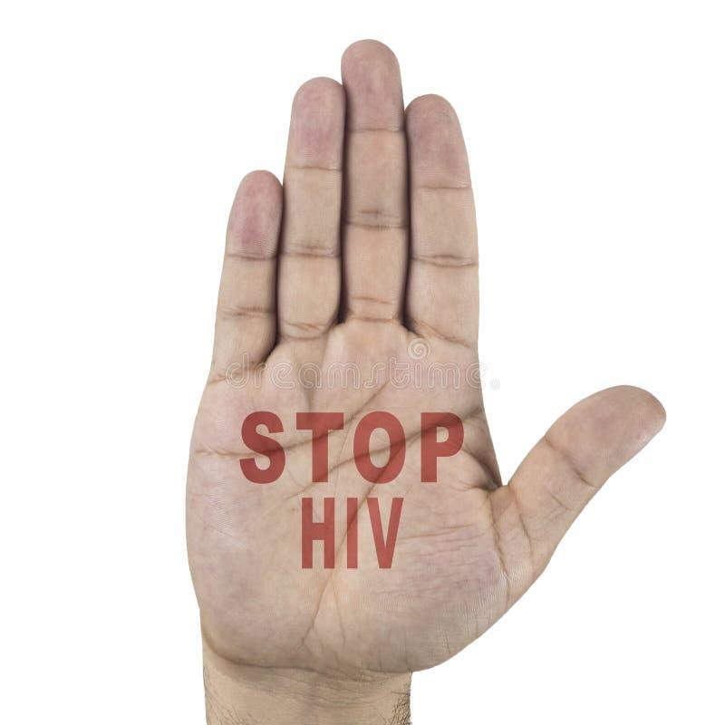 停止在男性` s手写的HIV词 背景查出的白色 图库摄影