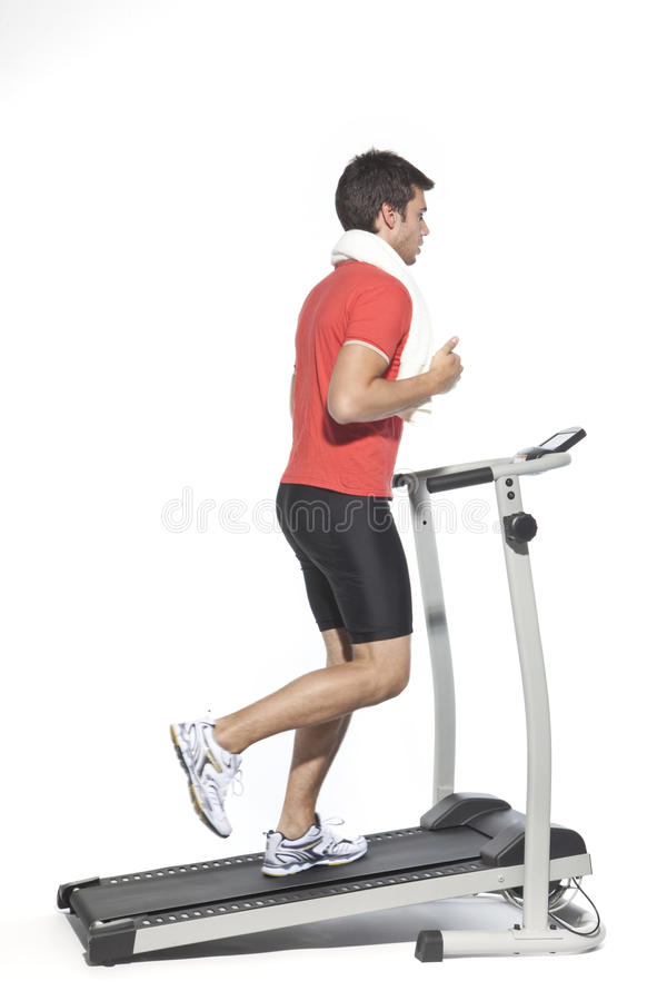健康人踏车锻炼年轻人 免版税库存图片