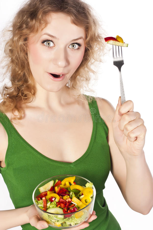 健康可爱的妇女,用沙拉 库存照片