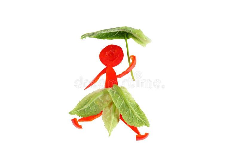 健康吃。胡椒的小滑稽的妇女。 免版税库存照片