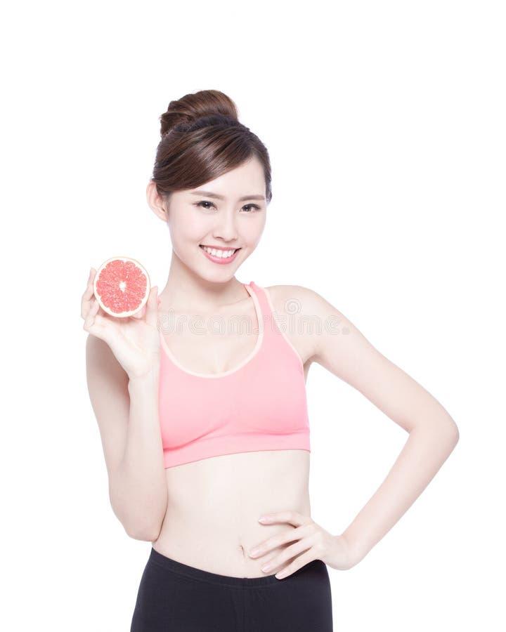 健康妇女用葡萄柚 库存照片