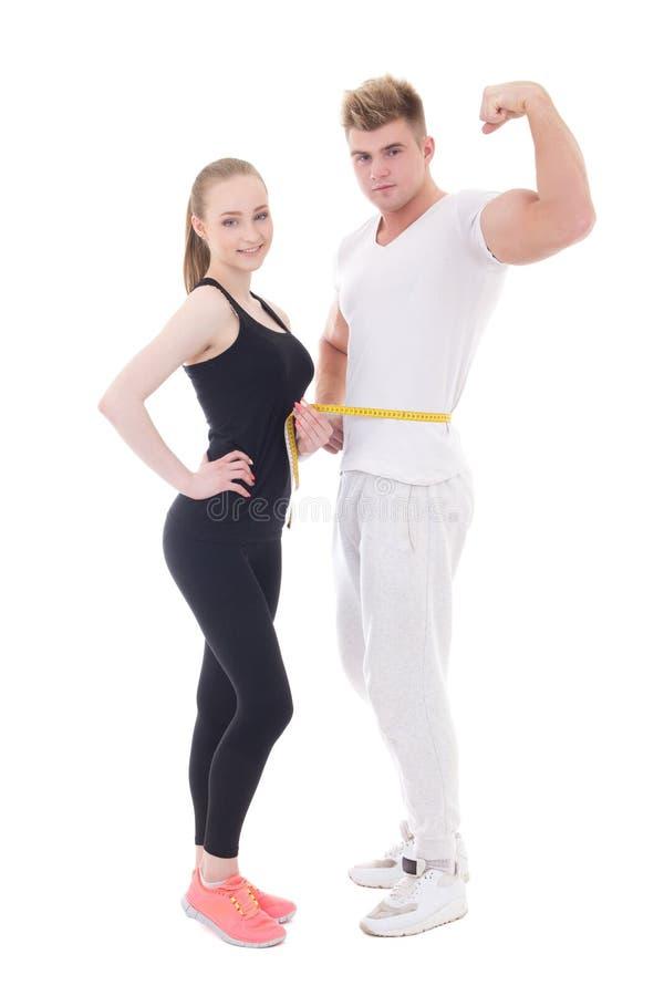 健康生活方式概念-肌肉男人和亭亭玉立的妇女被隔绝 库存照片