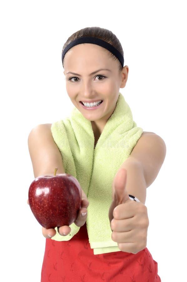 健康生活方式-健身妇女手苹果 免版税图库摄影