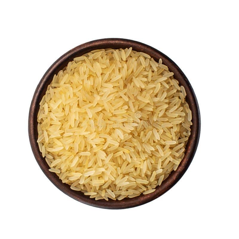 健康的食物 布朗碗用在白色背景隔绝的米 顶视图 免版税图库摄影