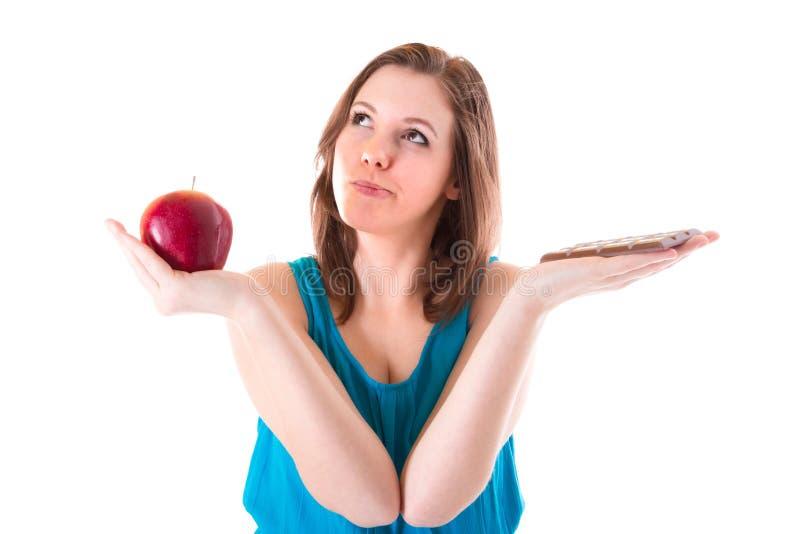 健康苹果或不健康的巧克力? 图库摄影