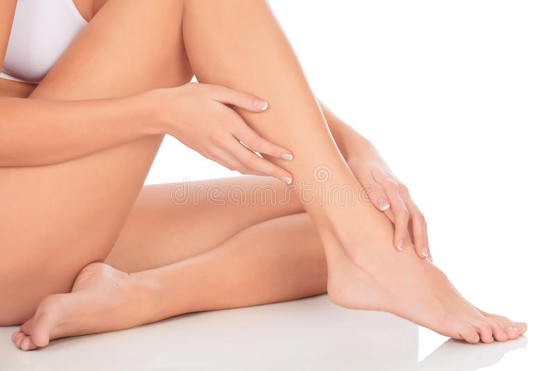 健康赤裸妇女腿和手 免版税库存照片
