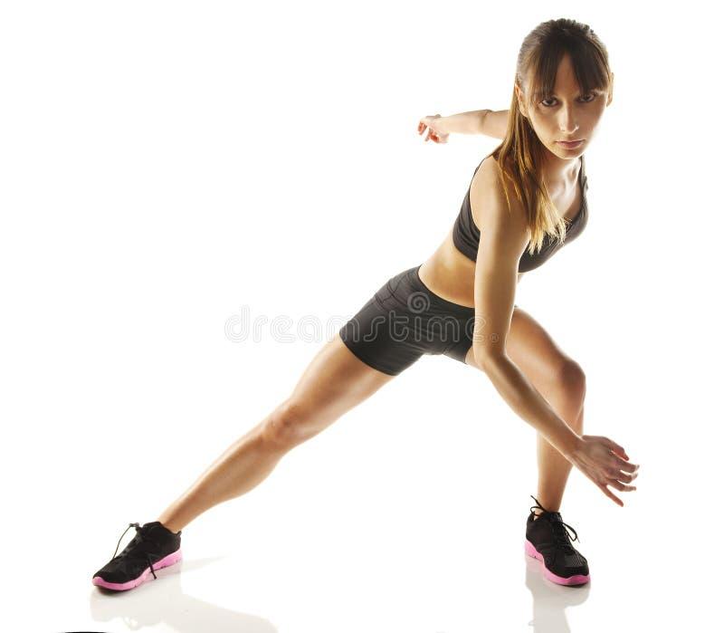 健身妇女执行有氧 免版税库存图片