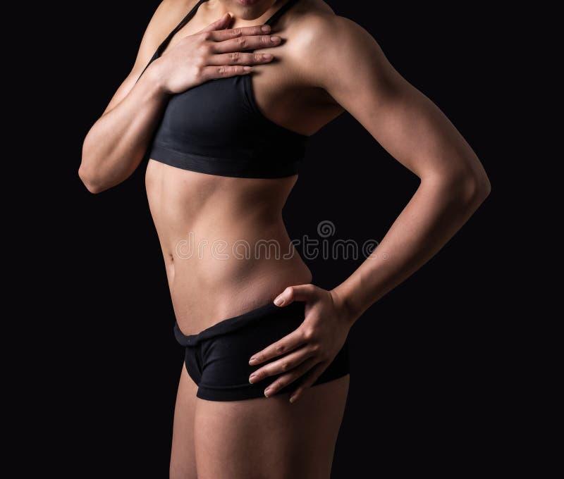健身妇女的美好的身体 免版税库存图片
