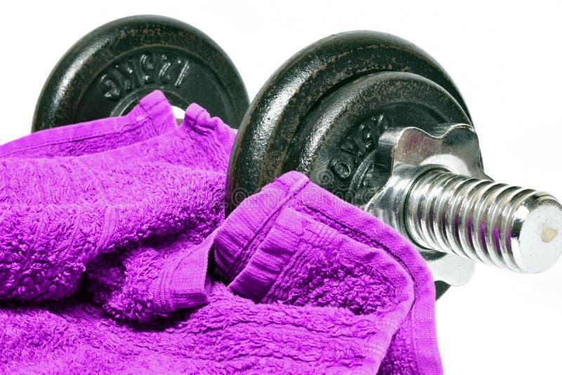 健身房哑铃 重量健身房 皮包骨头,保险开关 库存图片