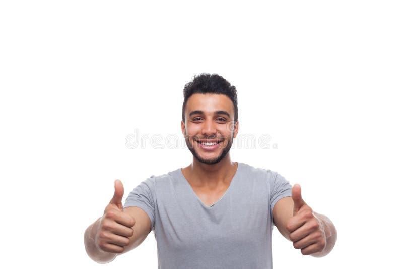 偶然人举行赞许愉快的微笑年轻英俊的人 库存照片