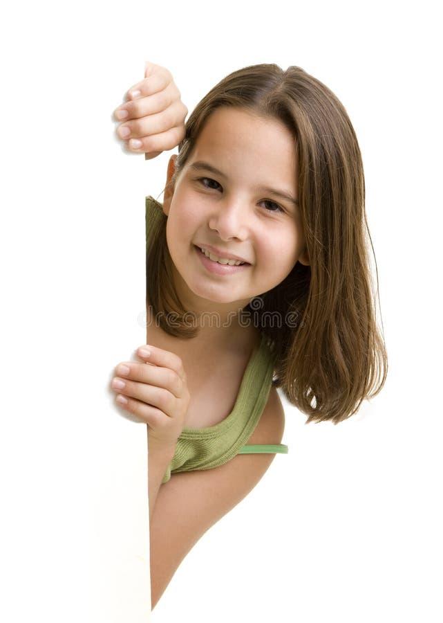偷看年轻人的女孩 库存图片