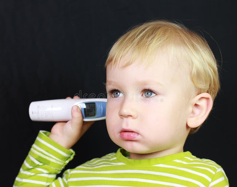 儿童不适温度计 免版税图库摄影