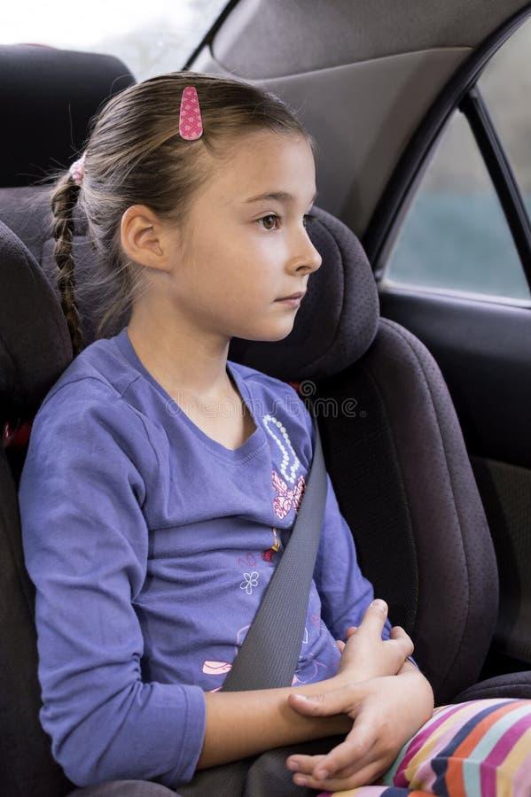 儿童位子的女孩 免版税库存照片