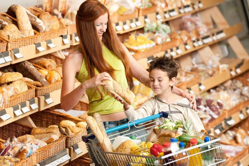 儿童副食品头发红色购物存储妇女 免版税库存照片
