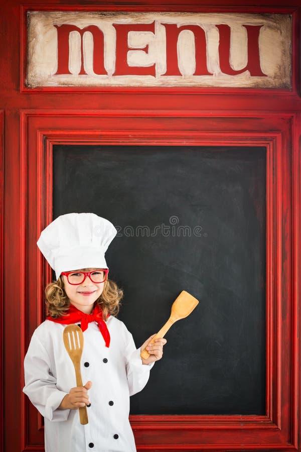 儿童厨师厨师 餐馆业概念 库存图片