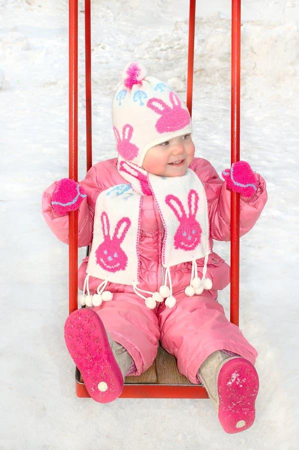 儿童女孩少许操场俏丽的s冬天 免版税图库摄影